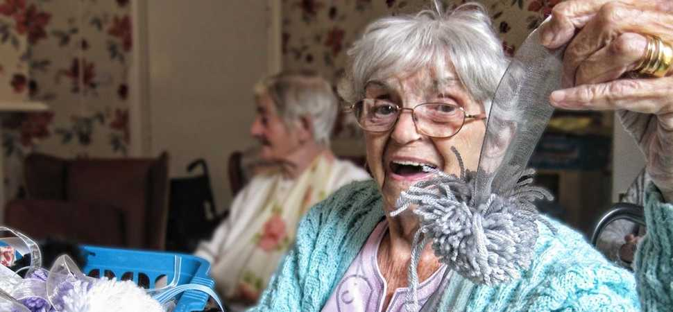 Droitwich care home pen pals  shaking their Pom Poms