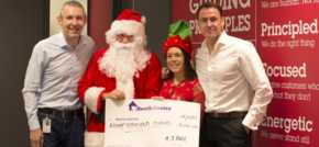 Selfies with Santa in AJ Bell charity fundraiser at Salford Quays HQ