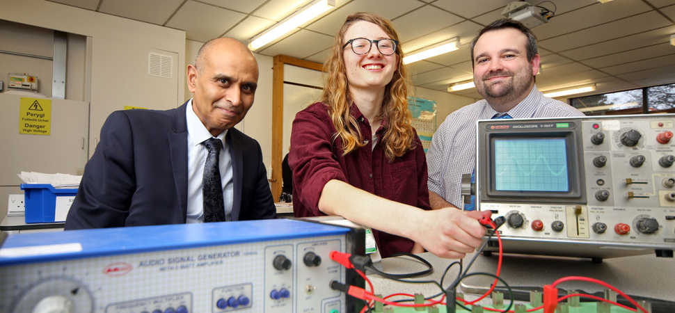 A student scoops school award for outstanding achievement in science