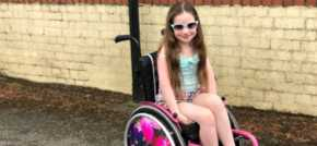 Amelia gets a perfect pink wheelchair!