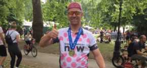 Shipping boss conquers 100-mile cycle ride for charity