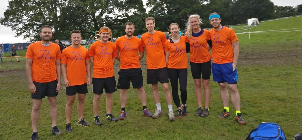 Pierce employees sweat mud and tears for Lancashire charities