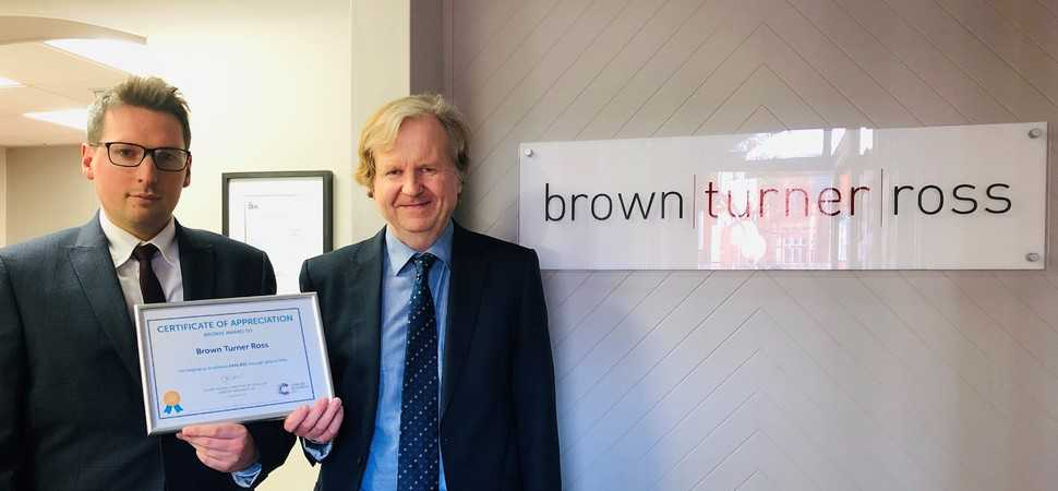 Brown Turner Ross solicitors honoured for helping secure Cancer Research funds