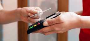 Paying with a mobile phone is now more secure than using a traditional bank cards, according to finance expert
