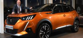 Simon Bailes Peugeot unveils all electric e-2008 SUV