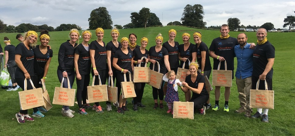 Forbes team tackles military obstacle course to help little Evie