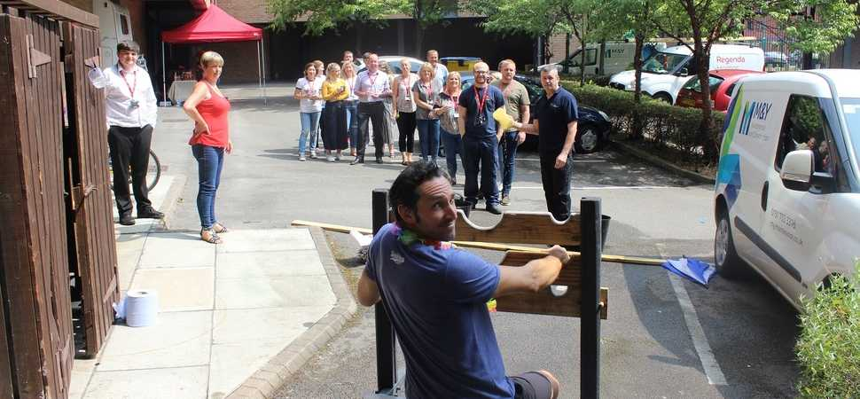 Its the stocks for you! Housing staff get soaked in the name of charity