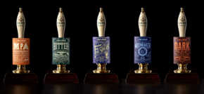 Squad toasts first taste of historic rebrand for JW Lees