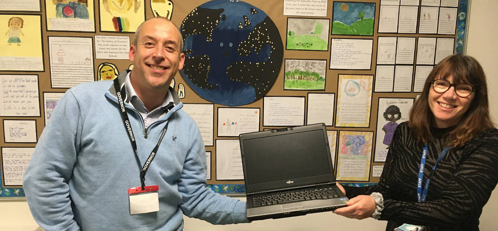 Small businesses join forces to provide laptops for school