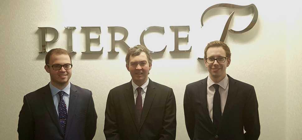 Pierce employees gain chartered status