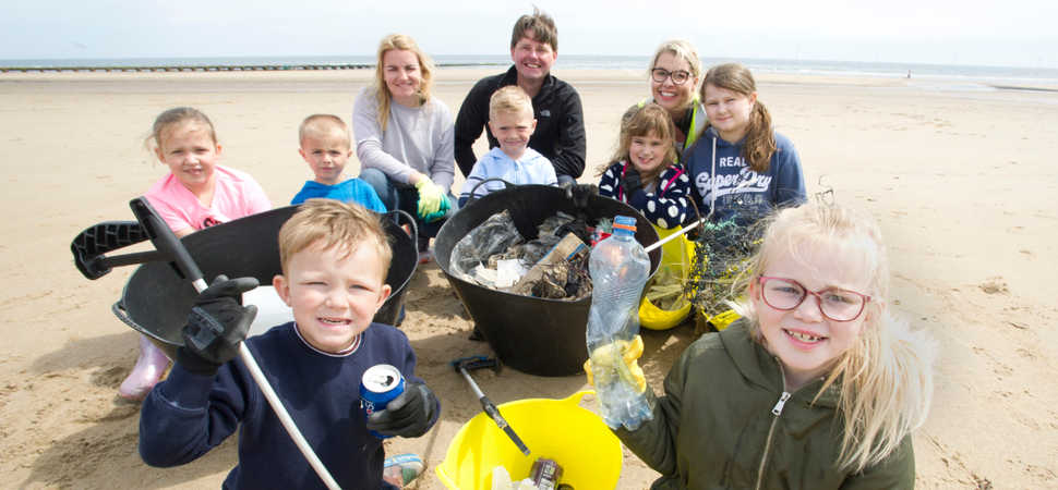 Primary school pupils discover waste including car parts during beach clean