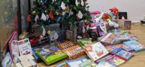 Axela donates hundreds of gifts to children in refuge through The Giving Tree