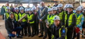 Leigh business buries centenary time capsules