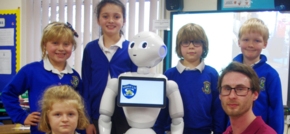 School children are entertained by humanoid robot