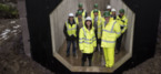 Cabinet secretary visits Jones Bros project to halt flooding of Tal-y-Bont