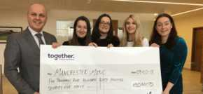Together presents cheque to Manchester Mind and announces its charities for 2018