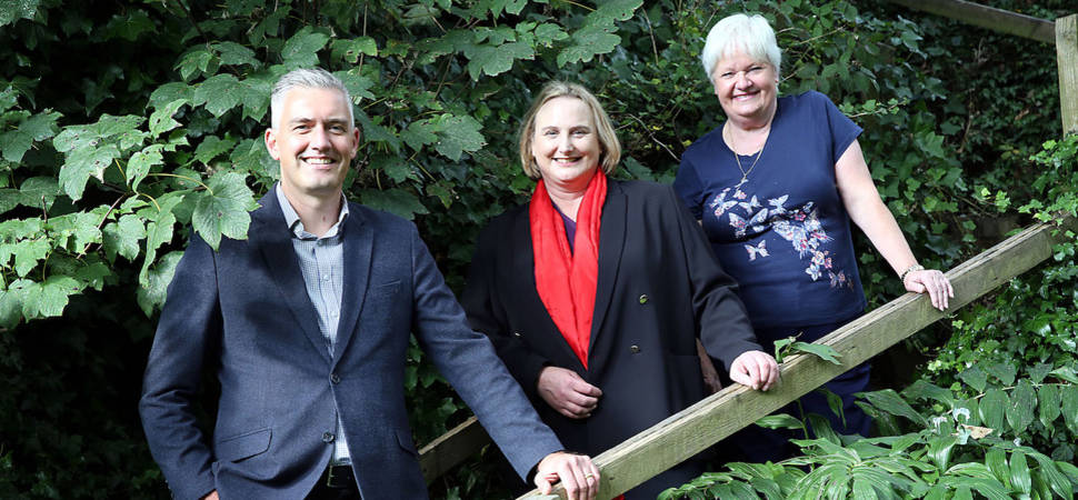 Solicitor Plants Seeds for Community Garden