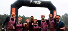 Energy employees descend into muddy madness to support charity