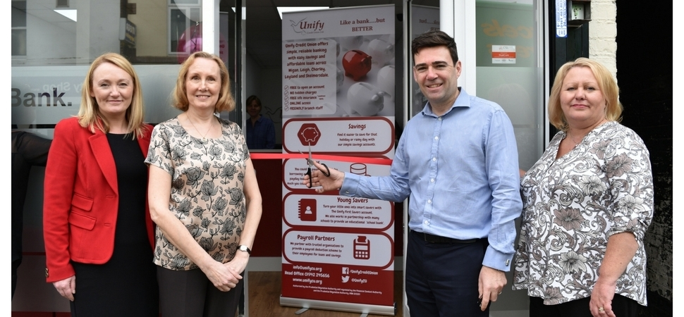 Members of Unify Credit Union in Leigh welcome a new branch opening